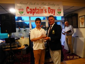 Captain Pat Leahy presenting the Juvenile Prize to Declan Roberts