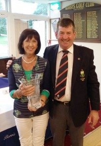 Captain Kevin Ryan presenting his Prize to Ladies to Bridie Galavan