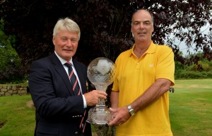 cyril-hughes-captain-of-borris-golf-club-presenting-his-prize-to-declan-roberts